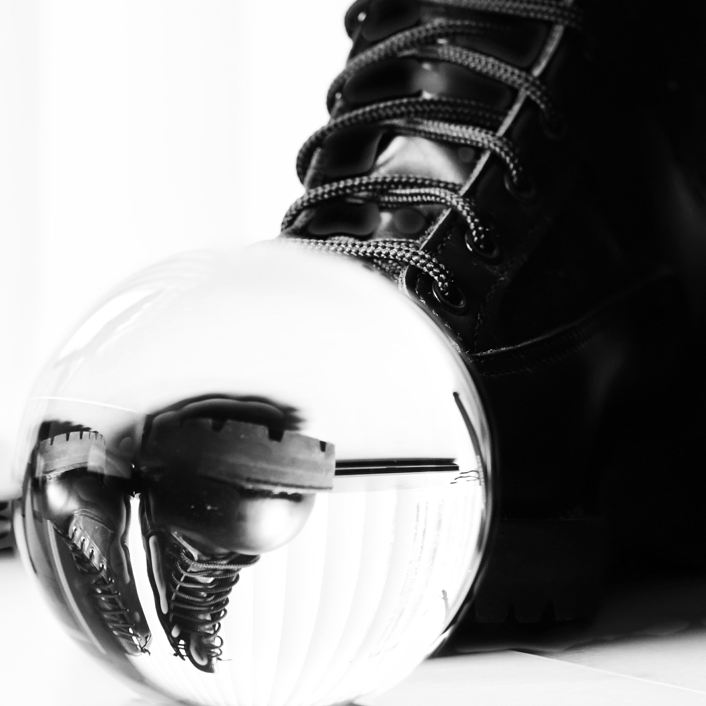 Boots Reflected in a Glass Ball